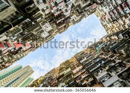 HONG KONG - MARCH 18 :Crowded residential in old district on March 18, 2015 in Hong Kong. With land mass of 1104 km and 7 million people, Hong Kong is one of most densely populated areas in the world - stock photo