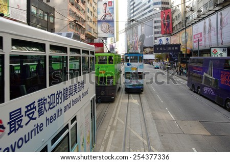 HONG KONG - MARCH 05: Double-decker trams on March 05, 2013 in Hong Kong. Hong Kong tram is the only system in the world run with double deckers, major tourist attraction in Hong Kong - stock photo