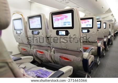 HONG KONG - MARCH 09, 2015: Emirates Airbus A380 aircraft interior. Emirates handles major part of passenger traffic and aircraft movements at the airport. - stock photo