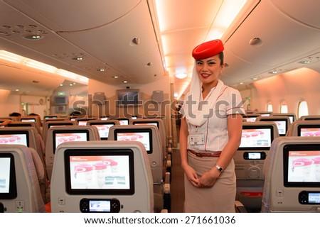 HONG KONG - MARCH 10, 2015: Emirates Airbus A380 crew member. Emirates handles major part of passenger traffic and aircraft movements at the airport. - stock photo