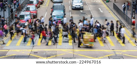 HONG KONG - MARCH 13, 2013: Pedestrians and traffic in Central is the central business district of Hong Kong. It is located in Central and Western District, on the north shore of Hong Kong Island.