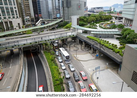 HONG KONG - MAY 7: Central District: Traffic and city life in this Asian international business and financial center. The city is one of the most populated areas in the world. Hong Kong May 7, 2015. - stock photo