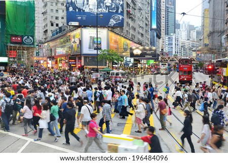 HONG KONG - MAY 17: Crowded market stalls in Ladies' Market, Mong Kok are in Hong Kong on May 17, 2014. It stretches one-kilometre with over 100 stalls of clothing, accessories and souvenirs. - stock photo