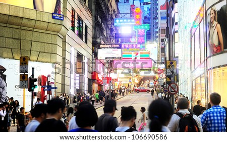 HONG KONG - MAY 21: Crowded street on May 21, 2012 in Hong Kong. With a land mass of 1,104 km and population of 7 million people, Hong Kong is one of the most densely populated areas in the world - stock photo