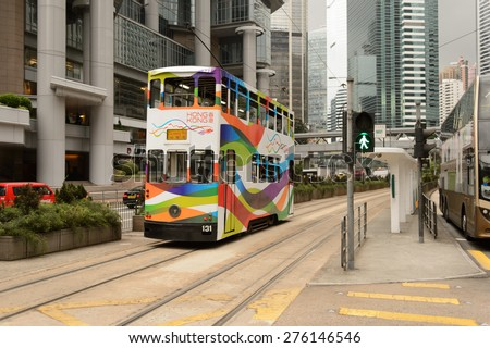 HONG KONG - MAY 05, 2015: double-decker tram on street of HK. Hong Kong Tramways is a tram system in Hong Kong, being one of the earliest forms of public transport in the metropolis. - stock photo