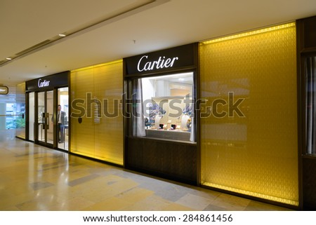 HONG KONG - MAY 6, 2015: Fashion house Cartier - Cartier designs, manufactures, distributes and sells jewelry and watches founded in France in 1847. - stock photo