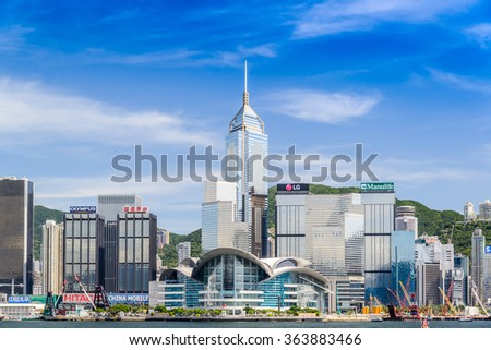 HONG KONG-MAY 2:Hong Kong Convention and Exhibition Centre (HKCEC, foreground) in Hong Kong on MAY 2, 2015. The original building was built on reclaimed land off Gloucester Road in 1988. - stock photo
