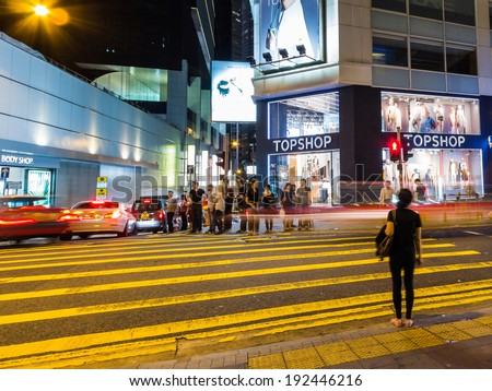 HONG KONG - MAY 10, 2014: People waiting to cross a busy street in Hong Kong  Hong Kong is one of the most densely populated areas in the world