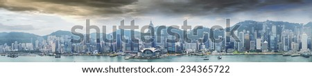 HONG KONG - MAY 12, 2014: Stunning panoramic view of Hong Kong Island skyline on a cloudy day. Last year HK hosted more than 54 million visitors, most of them from the mainland. - stock photo