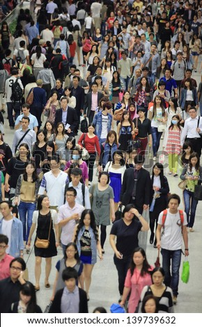 HONG KONG -MAY 13: The crowd of people in tunnel of Central subway station on May 13 2013. 6 p.m. is the peak of rushing hour in central because all people come off work