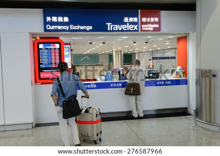 HONG KONG - MAY 06, 2015: Travelex counter in airport. Travelex Group is the world's largest foreign exchange bureau and is a major donor and sponsor of the Royal National Theatre. - stock photo