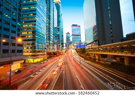 Hong Kong modern buildings backgrounds of city road light trails - stock photo