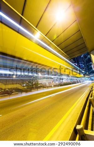 Hong Kong modern landmark building of city road light trail - stock photo