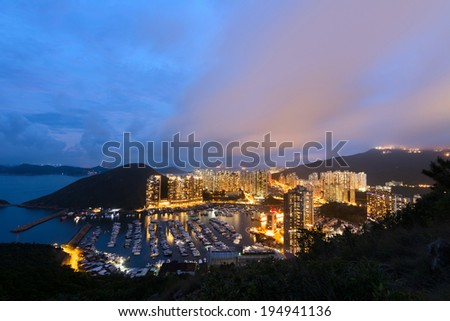 Hong Kong night scene with harbor and skyscrapers in Aberdeen, Hong Kong, Asia. - stock photo