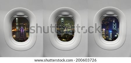Hong Kong night view at Airplane window - stock photo