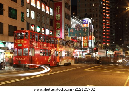 HONG KONG - NOV 27: Double decker tramway at night downtown in Central District of Hong Kong. November 27, 2010 in Hong Kong, China