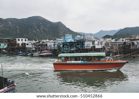 HONG KONG-NOV 2,2016:Market street in a small chinese fishing village Tourist are visiting by pleasure boat a fishing town in Tai o,hongkong