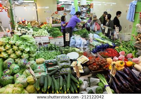 HONG KONG - NOV 27: Vegetable market in the Central District of Hong Kong. November 27, 2010 in Hong Kong, China - stock photo
