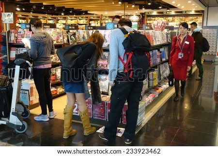 HONG KONG- NOVEMBER 22: Customers shop for books on 23 November 2014 in Hong Kong Airport. Hong Kong airport provides the best shopping experience to the passengers.