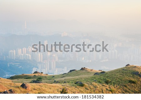 Hong Kong obscured by air pollution, as seen from the Kowloon hills - stock photo