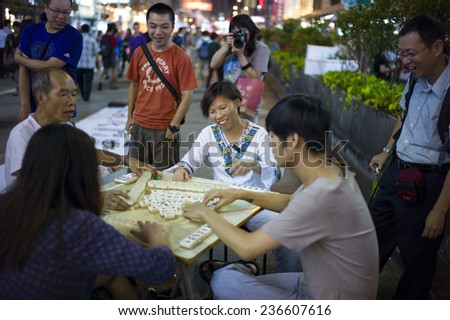 HONG KONG - OCT 15: People gather together and play mahjong in the middle of the road during Occupy Central movement in Mongkok in Hong Kong on October 15 2014. - stock photo
