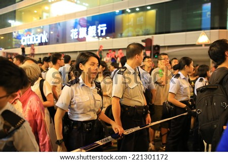 HONG KONG, OCT 1: protesters occupy the road and conflict to the government supporter in Mongkok on 1 October 2014.after police fire tear shell to the peaceful protesters, more people join the protest - stock photo