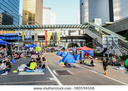 HONG KONG, OCT 2014: Tents set up to block the road at the Admiralty during Umbrella Revolution. - stock photo