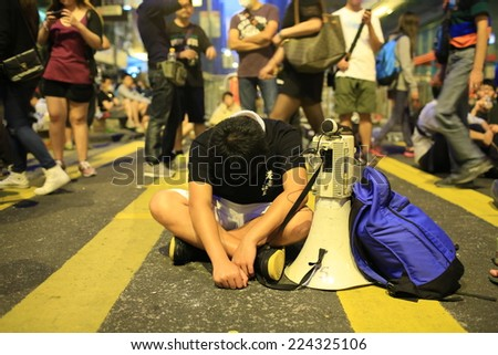 HONG KONG, OCT.17: young protesters sleep in Mong Kok on 17 October 2014. during Umbrella revolution, police clear the roadblock, but one day after protester occupy the road again - stock photo