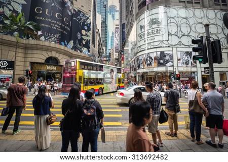 HONG KONG - OCTOBER 25, 2014. Busy Pedestrian Crossing at Queen's Road Central