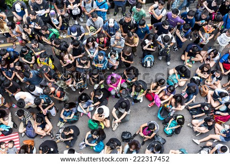 Hong Kong - October 1 2014: Hong Kong Occupy Central Protests. Protesters gather in the streets outside the Hong Kong Government Complex in Admiralty, Hong Kong. - stock photo