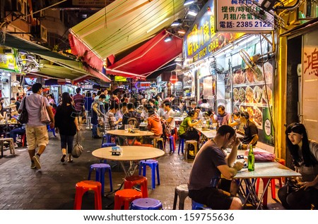 HONG KONG - OCTOBER 14:Temple Street :It is known for its night market and one of the busiest flea markets at night in the territory. October 14 ,2013 in Hong Kong - stock photo