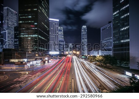 Hong Kong rush and busy traffic captured at night in central district - stock photo