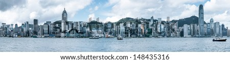 Hong Kong's Victoria Harbour, the tall buildings of the financial business district. - stock photo