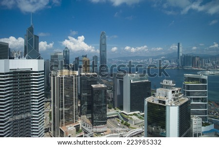 HONG KONG - SEP 15: Commercial buildings in Central on September 15, 2014 in Hong Kong. With a population of seven million, The city is one of the most densely populated in the world.  - stock photo