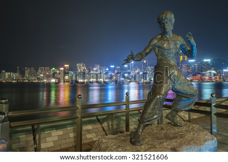 HONG KONG - SEPT. 25 : Bruce Lee statue on the Avenue of Stars on Sept 25, 2015 in Tsim Sha Tsui, Hong Kong. The statue is one of the main attractions on the famous waterfront promenade.  - stock photo