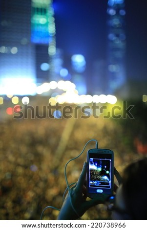 HONG KONG, SEPT.30: protesters take picture to the crowds in Admiralty on 30 September 2014. after riot police fire tear shell to the peaceful protesters on 28 sept, more people join the protest - stock photo