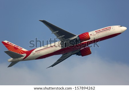 HONG KONG - SEPTEMBER 26: An Air India Boeing 777 taking off on September 26, 2013 in Hong Kong. Air India is the flag carrier airline of India with 101 planes in operation. - stock photo