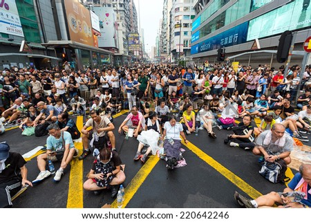 Hong Kong - September 30 2014: Hong Kong Occupy Central Protests. People protest on the Argyle Street and Nathan Road in Kowloon - stock photo