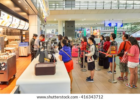 HONG KONG - SEPTEMBER 09, 2015: McDonald's restaurant at Hong Kong International Airport. McDonald's is the world's largest chain of hamburger fast food restaurants, founded in the United States. - stock photo