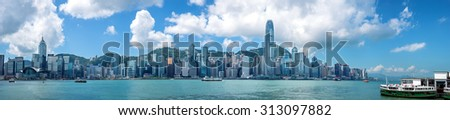 HONG KONG - September 4, 2015: Victoria Harbor and Hong Kong Island Skyline Panorama. Hong Kong is one of the most densely populated City.