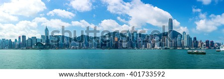 HONG KONG - September 6, 2015: Victoria Harbor and Hong Kong Island Skyline Panorama. Hong Kong is one of the most densely populated City.