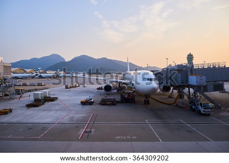 HONG KONG - SEPTEMBER 09, 2015: view on docked flight from Hong Kong International Airport Terminal. It is the main airport in Hong Kong. The airport is located on the island of Chek Lap Kok