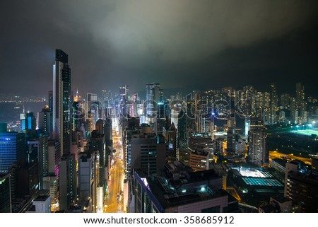Hong Kong skyline at night from rooftop. - stock photo