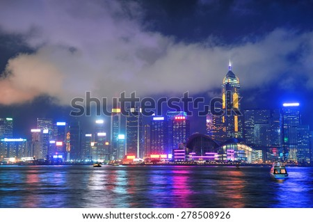 Hong Kong skyline at night with clouds over Victoria Harbour. - stock photo
