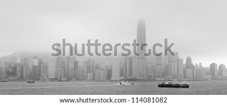 Hong Kong skyline black and white in a foggy day. - stock photo