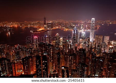 Hong Kong skyline from Victoria Peak, at night. View of the island and Kowloon sides. - stock photo