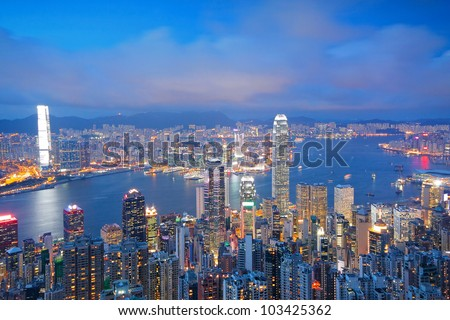 Hong Kong skyline from Victoria Peak at sunrise - stock photo