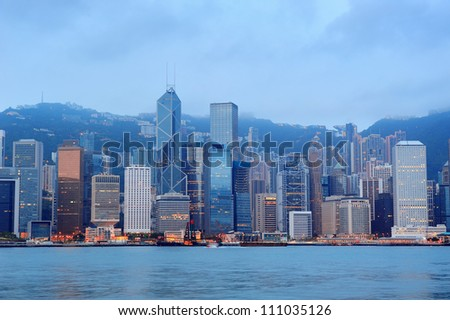 Hong Kong skyline in the morning over Victoria Harbour. - stock photo