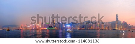 Hong Kong Victoria Harbor morning with urban skyscrapers over sea lit with reflections. - stock photo