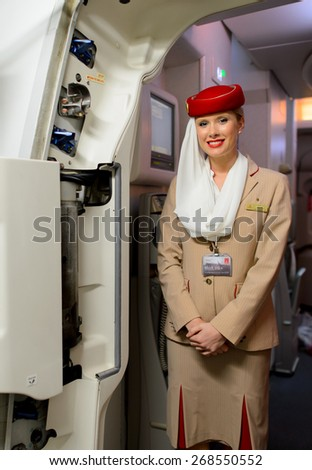 HONGKONG, CHINA - DECEMBER 10, 2014: Emirates Airbus A380 crew member. Emirates handles major part of passenger traffic and aircraft movements at the airport. - stock photo